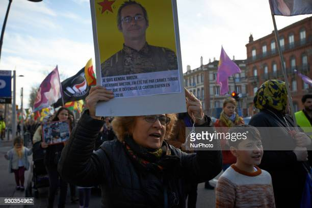 A kurd woman shows a placard depicting French fighter Kendal Breizh Kurds demonstrate to pay tribute to French fighter Kendal Breizh killed by...