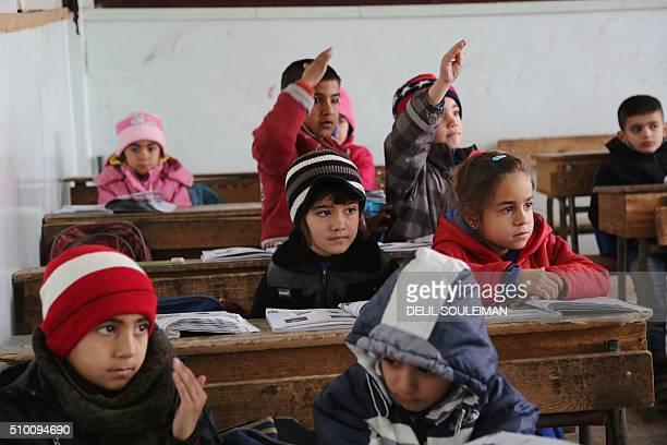 Kurdish and Arab children attend a class at the Musa Bin Nusayr school in the northeastern Syrian city of Qamishli on January 31 2016 The Kurdish...