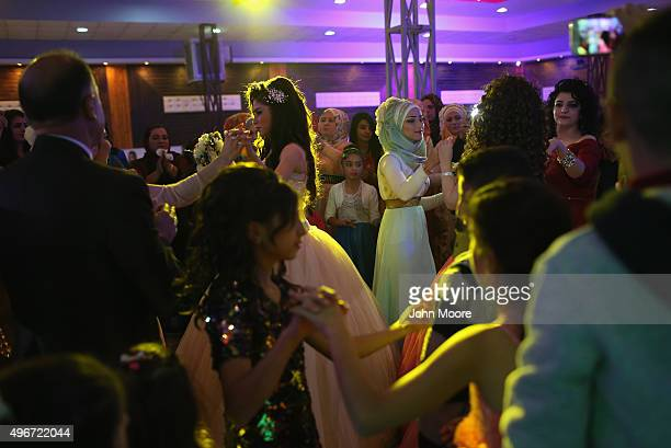 Kurdish bride Mezgin Murat dances during her wedding reception without her groom on November 11 2015 near Qamishli in the autonomous region of Rojava...