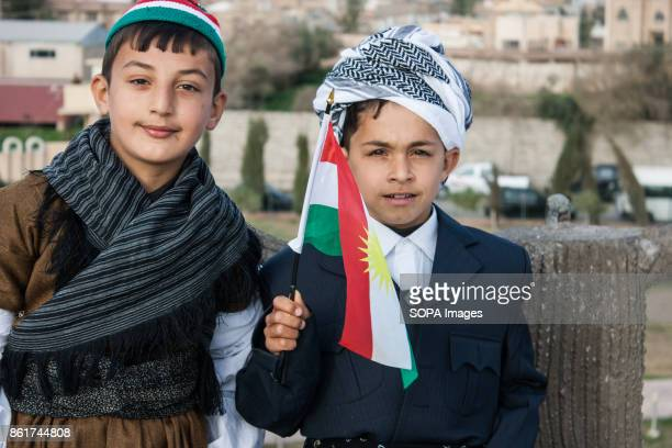 Kurdish children are seen wearing traditional clothes while holding a flag of Kurdistan during the Nowruz Festival Nowruz means a 'new day daylight'...
