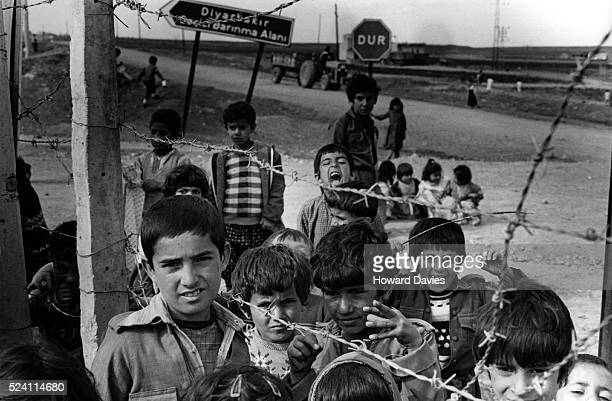 Kurdish children gather alongside barbed wire fencing at the Diyarbakir refugee camp Turkey The refugees fled Iraq following chemical weapon attacks...