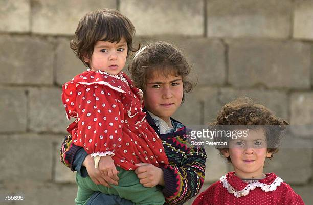 Kurdish children pose for a photograph March 28, 2002 in Halabja, Northern Iraq. The regime of Saddam Hussein attacked the Kurdish enclave with...
