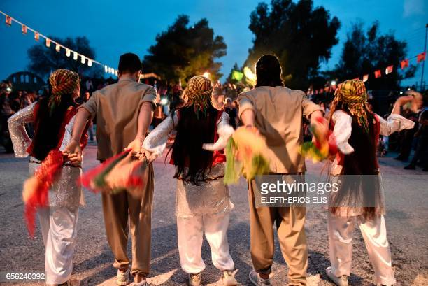 Kurdish community members living in Greece dance during Newroz celebrations on March 21 2017 in Lavrio some 80 kilometres from Athens Kurds celebrate...