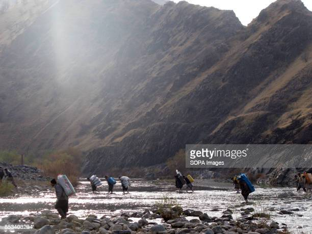 Kurdish couriers are crossing the river carrying heavy Chinese products For decades the IraqIran border has served as a smuggling route mainly to...