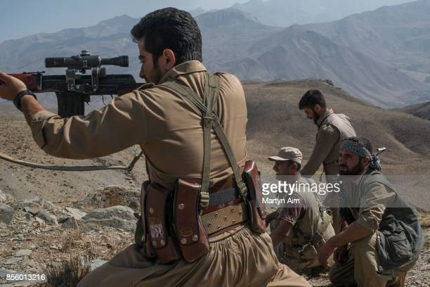 Kurdish Democratic Party of Iran guards the Iraq border with Iran on July 28, 2017 in the Zagros Mountains, northern Iraq. The KDP-I party is banned...