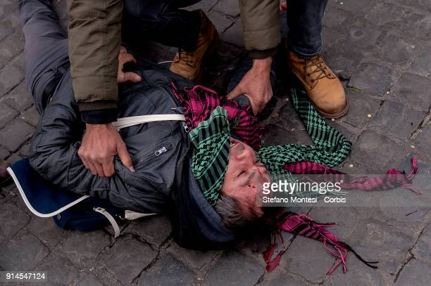 Kurdish demonstrator wounded by police during a demonstration against Turkish President Recep Erdogan's visit to to Rome and the Vatican near the...