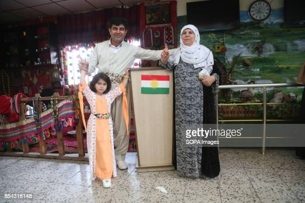 Kurdish family at one of the polls stations is pictured after casting their votes September 25 2017 is a historic day for Kurdish people around the...