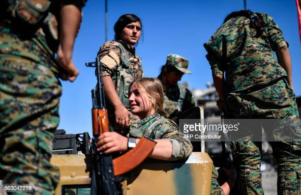 TOPSHOT Kurdish female fighters of the Syrian Democratic Forces gather during a celebration at the iconic AlNaim square in Raqa on October 19 after...