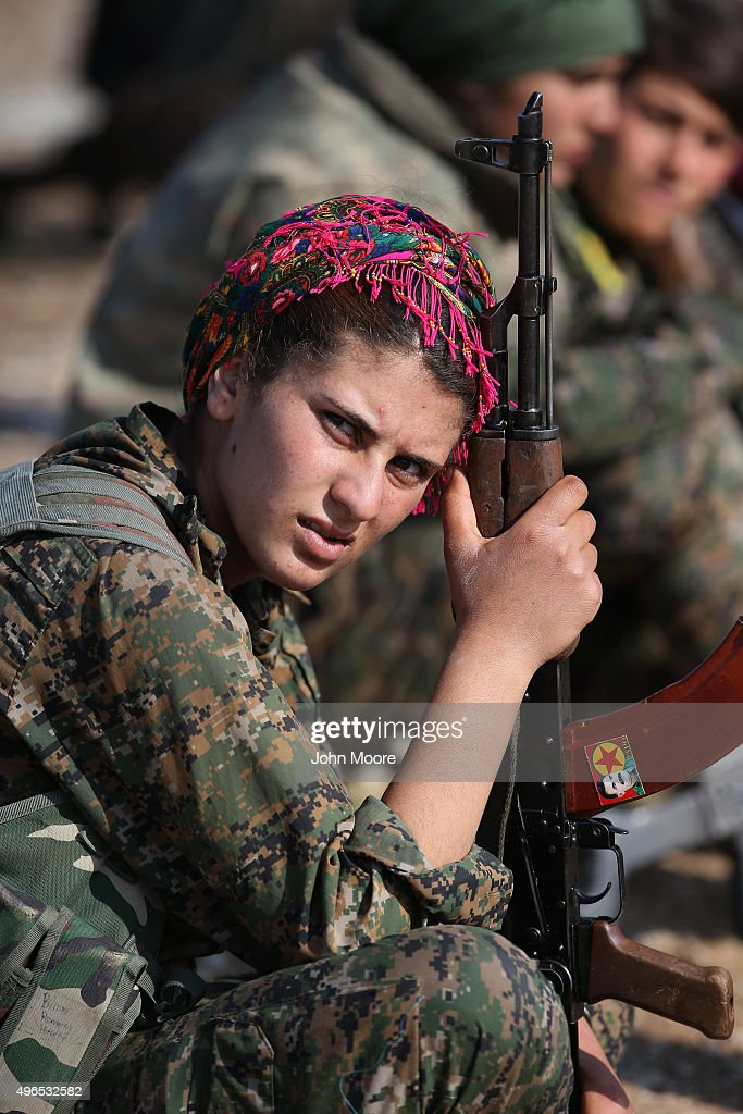 A Kurdish female soldier from the Syrian Democratic Forces rests from frontline action at a forward operating base on November 10, 2015 near the ISIL-held town of Hole in the autonomous region of Rojava, Syria. The forces, primarily Kurdish, are attacking ISIL extremists in the area near the Iraqi border and calling in airstrikes from U.S.-led coalition warplanes. The autonomous region of Rojava in northern Syria has become a bulwark against the Islamic State. The Rojava armed forces, with the aid of U.S. airstrikes and weapons, are retaking territory which had earlier been captured much by ISIL from the Syrian regime.