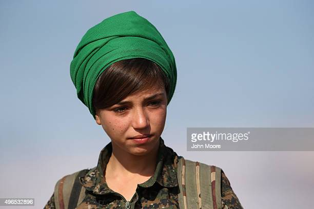 Kurdish female soldier from the Syrian Democratic Forces rests from frontline action at a forward operating base on November 10, 2015 near the...