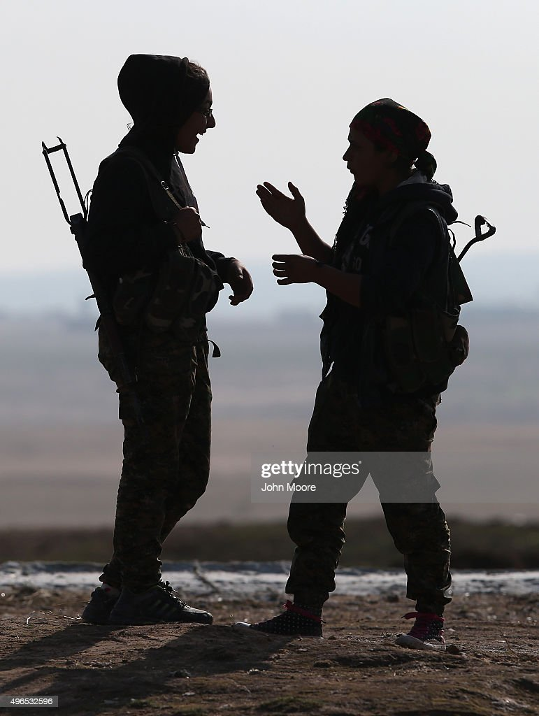Kurdish female soldiers from the Syrian Democratic Forces take a break from frontline action at a forward operating base on November 10, 2015 near the ISIL-held town of Hole in the autonomous region of Rojava, Syria. The forces, primarily Kurdish, are attacking ISIL extremists in the area near the Iraqi border and calling in airstrikes from U.S.-led coalition warplanes. The autonomous region of Rojava in northern Syria has become a bulwark against the Islamic State. The Rojava armed forces, with the aid of U.S. airstrikes and weapons, are retaking territory which had earlier been captured much by ISIL from the Syrian regime.