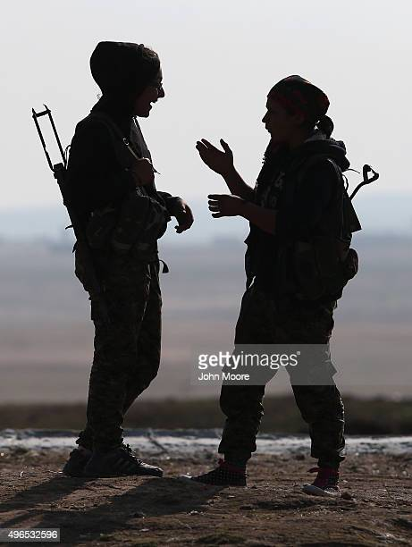 Kurdish female soldiers from the Syrian Democratic Forces take a break from frontline action at a forward operating base on November 10 2015 near the...