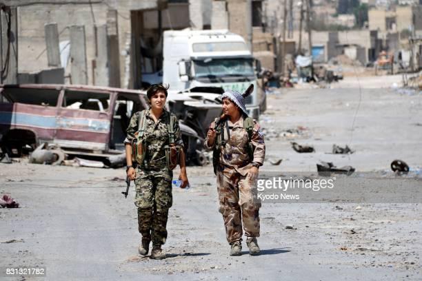 Kurdish female soldiers walk on a street in Raqqa northern Syria on Aug 11 2017 ==Kyodo