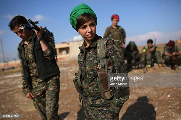 Kurdish female troops from the Syrian Democratic Forces stand in a forward operating base overlooking the frontline on November 10 2015 near the...