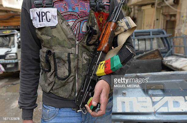 A Kurdish fighter from the 'Popular Protection Units' is pictured in the majorityKurdish Sheikh Maqsud district of the northern Syrian city of Aleppo...