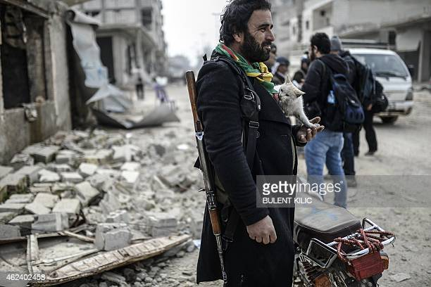 Kurdish fighter holds a cat in the center of the Syrian town of Kobane, also known as Ain al-Arab, on January 28, 2015. Kurdish forces recaptured the...