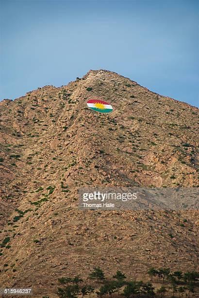 Kurdish flag above hill