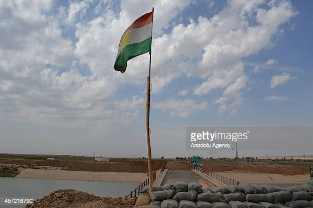 Kurdish flag is seen as Peshmerga fighters hold a position on the front line against Islamic State of Iraq and the Levant in Kirkuk in northern Iraq...