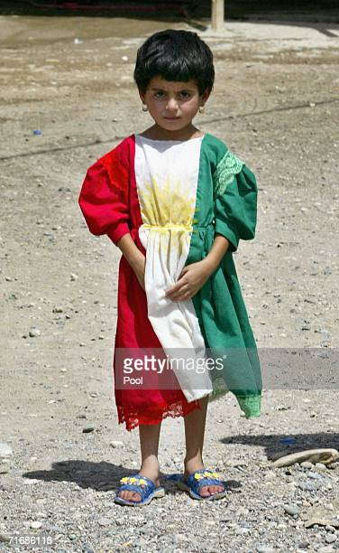 Kurdish Iraqi girl wears a dress displaying the colours of the Kurdish flag outside the fortress which was allegedly formerly used by the Iraqi Army...