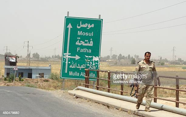 Kurdish Iraqi Peshmerga forces deploy their troops on the outskirts of the multiethnic city of Kirkuk only 1 kilometre away from areas controlled by...