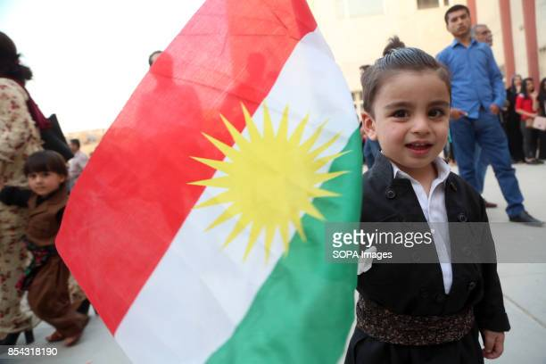 Kurdish little boy is pictured while holding a Kurdish flag September 25 2017 is a historic day for Kurdish people around the world as many Kurdish...