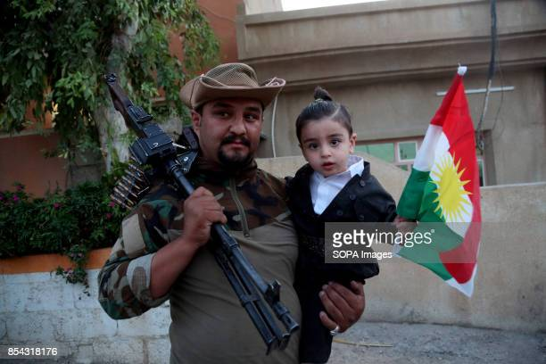 Kurdish Man and his boy are pictured while participating to the referendum September 25 2017 is a historic day for Kurdish people around the world as...