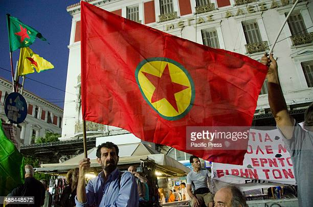 Kurdish man holds a giant Kurdish flag during the rally Greek Left Wing Political Party Popular Unity organized its major preelection rally in...