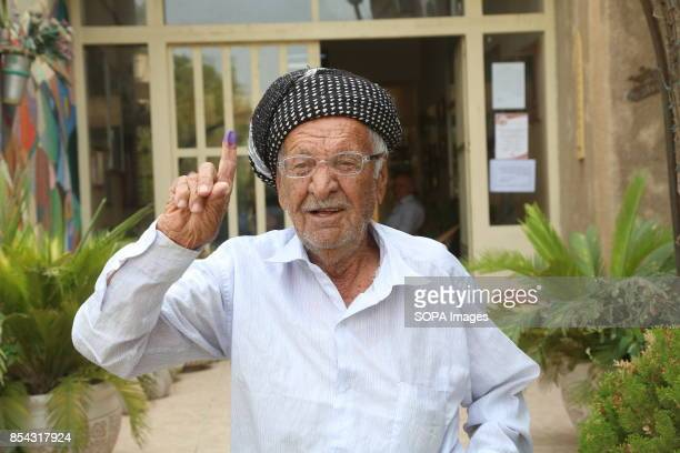 A kurdish man is pictured after casted his vote at the polling station September 25 2017 is a historic day for Kurdish people around the world as...