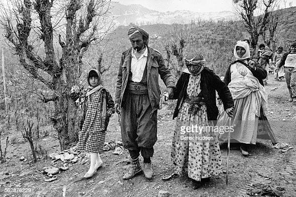 Kurdish man leads his grandmother daughter and his wife down a mountain path towards the makeshift camp near Isikveren Turkey The Iraqi Kurdish...
