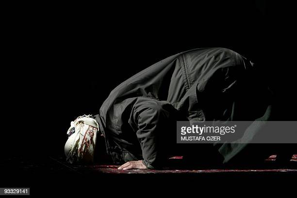 A Kurdish man prays at the Savaf mosque during weekly Friday prayers in the northern Iraqi Kurdish city of Arbil 28 January 2005 Iraqi Kurds will...