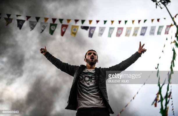 A Kurdish man shouts slogans as Turkish Kurds gather for Newroz celebrations for the new year in Diyarbakir southeastern Turkey on March 21 2017...