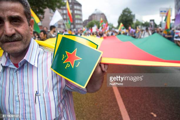 Kurdish man takes a part in manifestacion during G 20 summit in Hamburg on July 8 2017