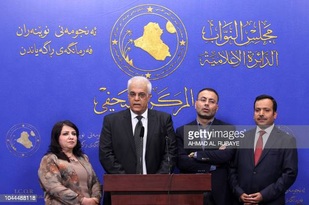 Kurdish members of the Iraqi federal parliament give a press conference ahead of the election of a new president of Iraq who by convention has always...