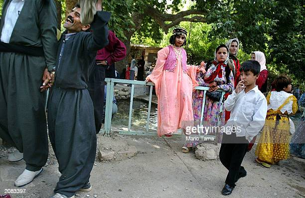 Kurdish men and children attend a traditional wedding celebration June 15 2003 in Bakochek Iraq Saddam Hussein's regime killed an estimated 180000...