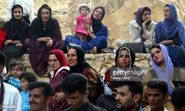 Kurdish men and women attend a traditional wedding celebration June 15, 2003 in Bakochek, Iraq. Saddam Hussein's regime killed an estimated 180,000...