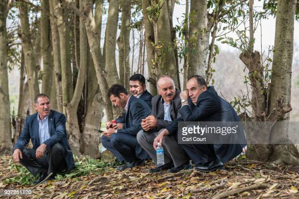Kurdish men chat during Nowruz celebrations on March 24 2018 in Tokyo Japan Nowruz meaning 'new day' and marking the first day of spring is widely...