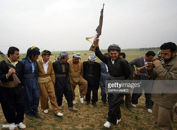 Kurdish men dance during a traditional wedding ceremony in the Kurdish city of Arbil northern Iraq on February 18 2010 AFP PHOTO/SAFIN HAMED