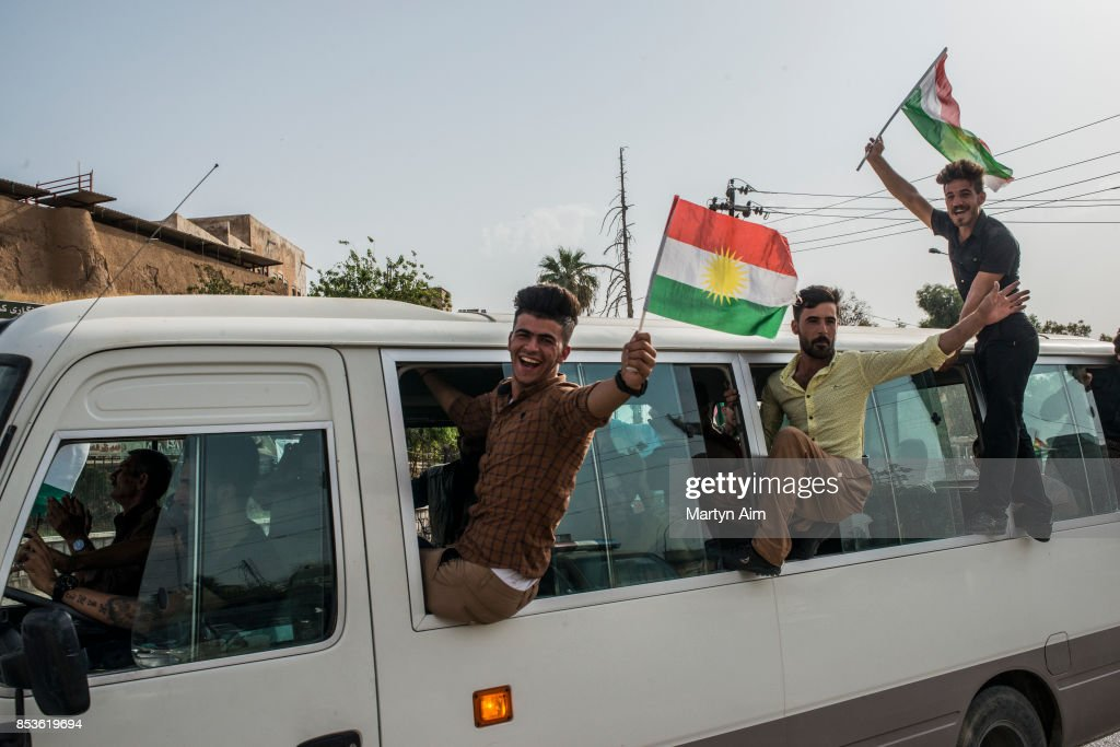 Kurdish men hold Kurdistan flags on their way to vote in a referendum to decide on independence from Iraq and the establishment of Kurdistan as a state on September 25, 2017 in Kirkuk, Iraq. Despite strong objection from neighboring countries and the Iraqi government. Some five million Kurds took to the polls today across three provinces in the historic independence referendum.