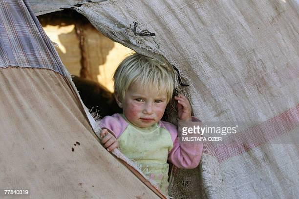A Kurdish nomad boy looks at the camera from his tent in Idil a district of Sirnak province near the TurkishIraq border 10 November 2007 Kurdish...