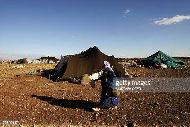 A Kurdish nomad woman leaves her tent to bring water in the outskirts of Idil a district of Sirnak province near the TurkishIraq border 10 November...