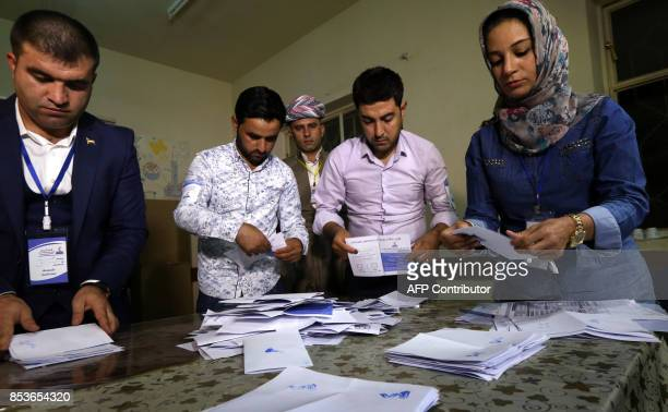 Kurdish officials count votes after the close of polls during the referendum on independence at a polling station in Arbil the capital of the...