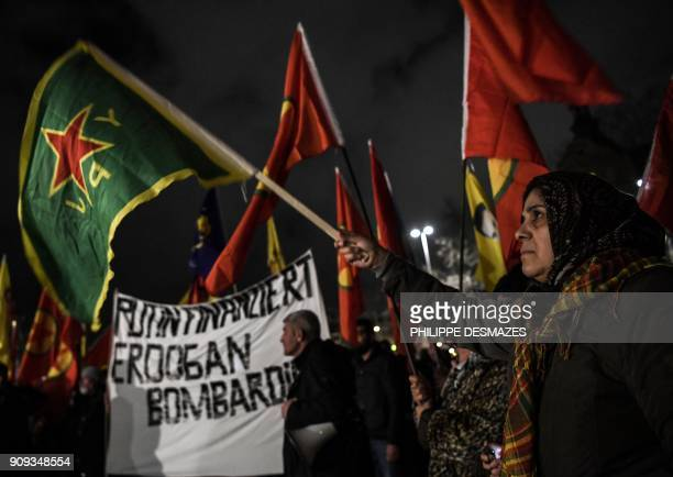 TOPSHOT Kurdish people against Turkey's assault on the northern Syrian enclave of Afrin as they protest against the attendance of the US president to...