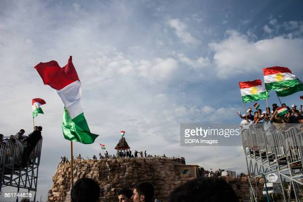 Kurdish people are seen holding flags of Kurdistan while gathering during the Nowruz Festival Nowruz means a 'new day daylight' is the traditional...