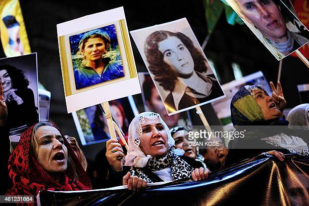 Kurdish people hold pictures of killed three kurdish activists and shout slogans during a demonstration on January 9 2015 at Istiklal avenue in...