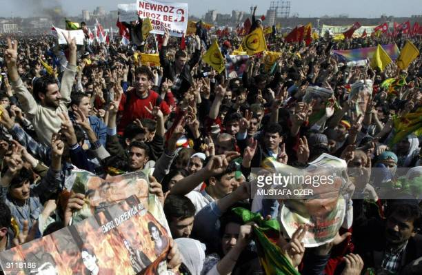 Kurdish people hold posters of the imprisoned Kurdish rebel leader Abdullah Ocalan during the celebrations of the Kurdish new year festival Newroz in...