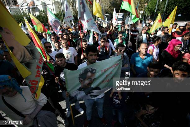 Kurdish people living in Greece shout slogans against Turkish president Recep Tayyip Erdogan as they stage a protest outside the Turkish Embassy in...