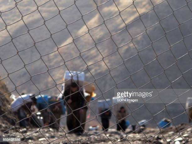 Kurdish people seen walking up to the harsh Irani border to transport the goods to final destination For decades the IraqIran border has served as a...