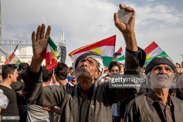 Kurdish people show their supoprt for the upcoming referendum for independence of Kurdistan in a gathering at Sulaimaniya Stadium