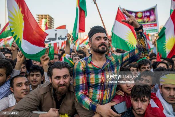 Kurdish people show their support for the upcoming referendum for independence of Kurdistan in a gathering at Franco Harriri Stadium.