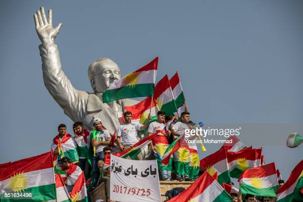Kurdish people show their support for the upcoming referendum for independence of Kurdistan in a gathering at Franco Harriri Stadium. At the placard...